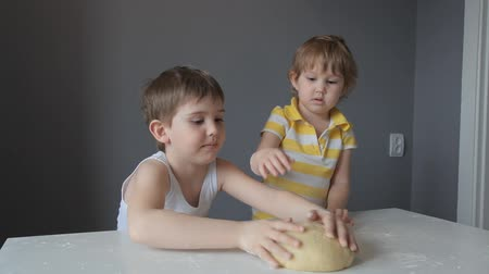 plastilina : two children a boy and a girl play with the test, have fun and laugh