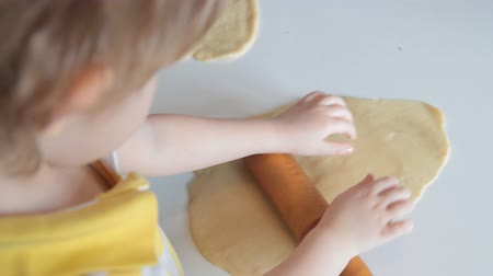 regozijo : baby girl makes cookie dough Stock Footage