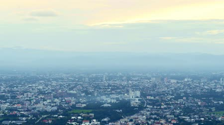 Time lapse of Chiang Mai city in high angle view in the morning. Viewpoint on Doi Suthep wayside.