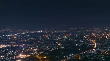 Time lapse of Chiang Mai city in high angle view in night. Viewpoint on Doi Suthep wayside. Stok Video
