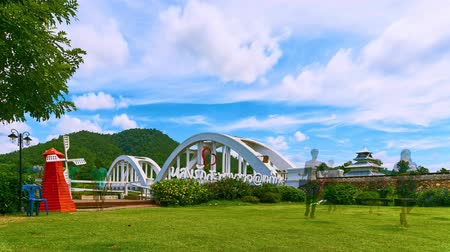 LAMPHUN, THAILAND - SEPTEMBER 9, 2018 : Time lapse  Tha Chomphu White Bridge landmark of Lamphun Province. An old railway bridge across the river.