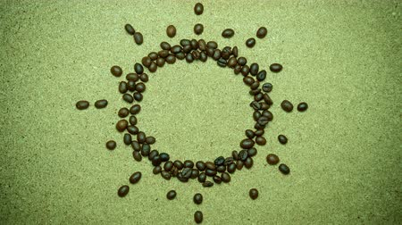 Stop motion animation The coffee bean moves as %u201CGood morning and the sun shape. The concept of the morning coffee time.