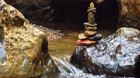 sponka : Stone balance stacking at riverside and morning sunlight. Concepts of Zen religion or meditation practice.