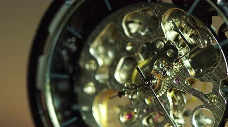 Closeup old pocket watch is rotating. Concept of valuable time and no time off.