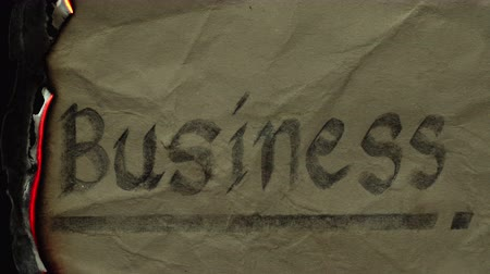 Burn the text of word business in the old paper. The concept of ending due to loss of business.