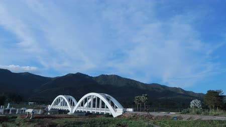 Dramatic stormy scenery countryside and Beautiful white bridge For the railway pass in lamphun Thailand Wideo