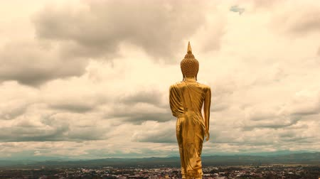 stormy and cloud is moving golden buddha standing