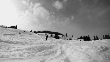 akció : Slow motion of a skier skiing down on the slope. Black and white HD movie