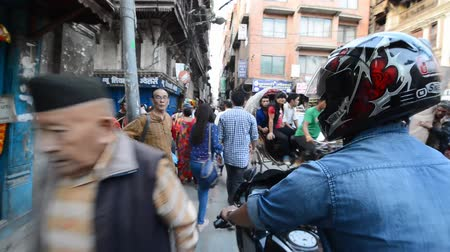 patan : KATHMANDU, NEPAL- SEPTEMBBER 28: Crowd of local Nepalese people and chaotic traffic on the streets during the Dashain festival in Kathmandu on Sept 28, 2013 in Kathmandu, Nepal