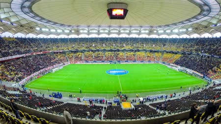match : Time lapse of National Arena stadium seats filling up with crowd of soccer fans of Dinamo Bucharest during a match against Steaua Bucharest, in the National Arena stadium, final score: 1-1. In Bucharest, Romania, on 17042014