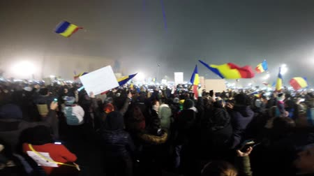 af : CLUJ NAPOCA, ROMANIA - FEBRUARY 5, 2017: More than 50.000 people singing the National Anthem of Romania during a protest against the corrupt Prime Minister and the Government