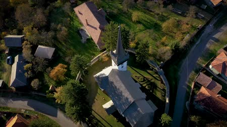 transilvânia : Aerial point of view drone footage of a protestant church in Transylvania, Romania