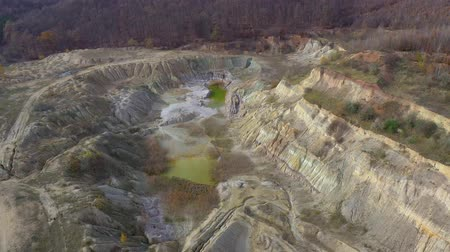 gips : Aerial drone 4k movie of abandoned and flooded open pit gypsum mine, quarry. Polluted lake and mud. Industrial landscape