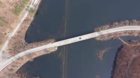 Aerial 4k view of a bridge crossing a lake from a drone Стоковые видеозаписи