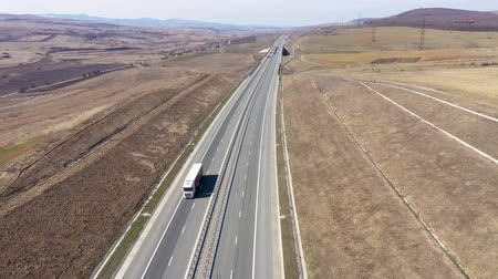 államközi : Aerial 4k top view of cars and trucks passing on a highway, drone shot