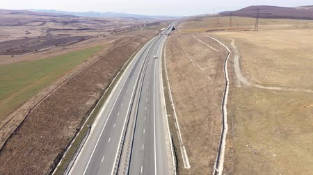 Aerial 4k top view of cars and trucks passing on a highway, drone shot