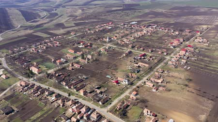 varoşlarda : Aerial 4k view of a village settlement from a drone in Transylvania, Romania Stok Video