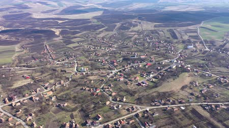 Aerial 4k view of a village settlement from a drone in Transylvania, Romania Стоковые видеозаписи
