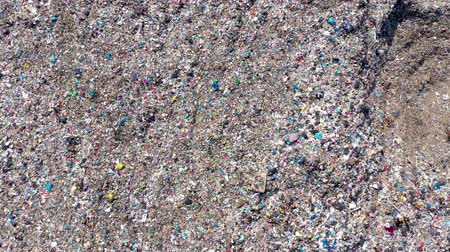 rakás : Environmental pollution.  Aerial top view from flying drone of large garbage pile. Garbage pile in trash dump or landfill