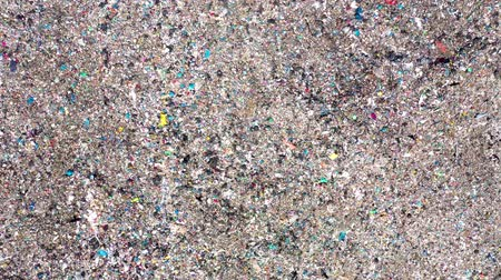 plastics : Aerial top drone view of large garbage pile, trash dump, landfill, waste from household dumping site, excavator machine is working on a mountain garbage. Consumerism and contamination concept
