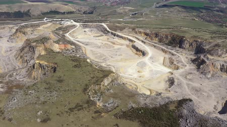 Aerial 4k drone view of a limestone quarry, open pit mine, mining industry Стоковые видеозаписи