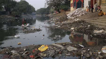 kolkata : Kolkata, India, January 2016. A boy plays in a heavily polluted river in a slum of Kalighat.