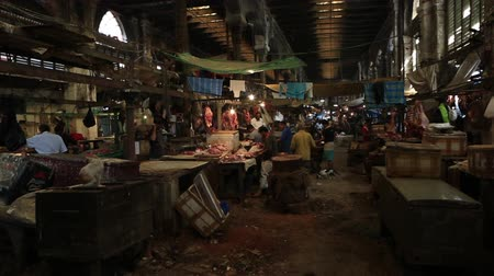 kolkata : Kolkata, India, February 2016. Butchers working in the New Market in an unhealthy environment. Stock Footage