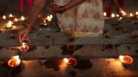 Lighting candles in a ghat on the Ganges River.