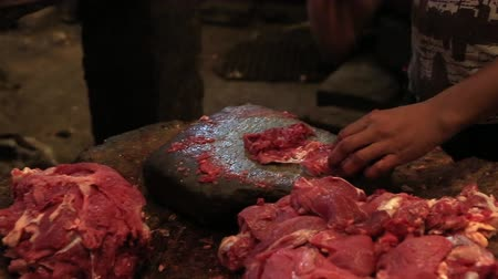 Cutting meat in one of the New Market stores. Stock mozgókép