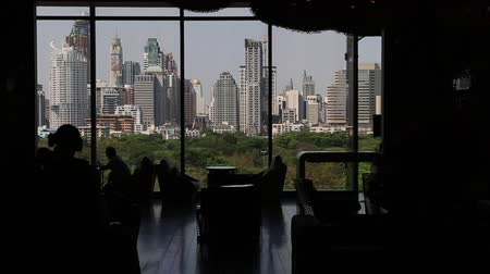 skyscraper : Bangkok, Thailand, March 2016: View of the skyscrapers of the city from the interior of a hotel. Stock Footage