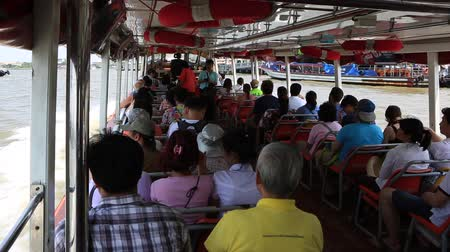 phraya : Bangkok, Thailand, March 2016: Inside the Chao Phraya Express Boat full of people.