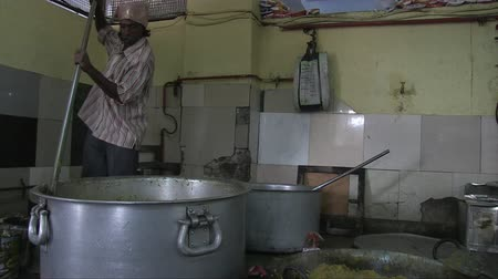 turban : Old Delhi, India, November 2011: Cooking for everyone at a Sikh temple in the city.