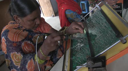 feminism : Barefoot College, Ajmer, India, January 2012. A woman works making electrical circuits for solar panels. Stock Footage
