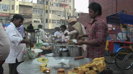 market vendor : Old Delhi, India, November 2011: Indian fast food on the street. Stock Footage