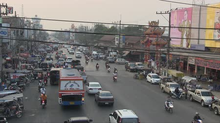 populace : Udon Thani, Thailand, February 2012: Aerial view of the street full of vehicles and people.
