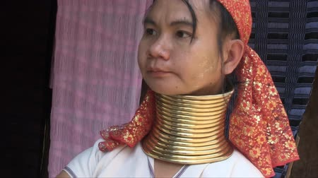 they : Mae Hong Son, Northern Thailand, March 2012: Close up of a woman in the Burmese Karen refugee village known for its long-neck women.