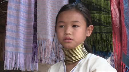 they : Mae Hong Son, Northern Thailand, March 2012: Close-up of a girl in the Burmese Karen refugee village known for its long-neck women. Stock Footage