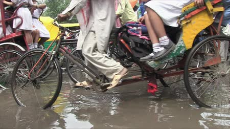 rickshaw : Old Delhi, India, November 2011: View of the narrow streets of the city full of vehicles and people. Stock Footage