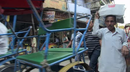 Old Delhi, India, November 2011: View of the narrow streets of the city full of vehicles and people. Wideo