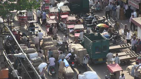 população : Old Delhi, India, November 2011: Aerial view of the narrow streets full of vehicles and people.