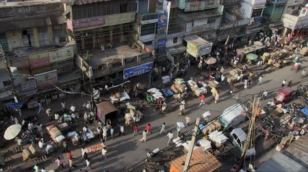 rickshaw : Old Delhi, India, November 2011: Aerial view of the narrow streets full of vehicles and people.