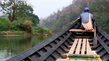 Mae Hong Son, Northern Thailand, March 2012: Sailing in a motorboat along the river in the jungle.