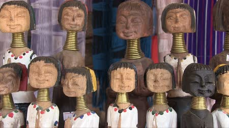 they : Mae Hong Son, Northern Thailand, March 2012: Close up of a souvenir shop in Karen Burmese refugee village known for its long-neck women. Stock Footage
