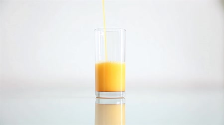 orange : Fresh orange juice flowing in a glass