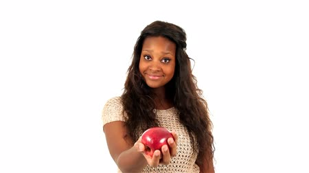 черные волосы : Young African American teenage girl sharing an apple, over white background