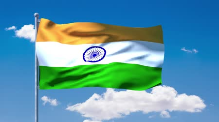 hint : Indian flag waving over a blue cloudy sky