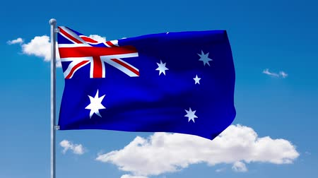 ausztrál : Australian flag waving over a blue cloudy sky
