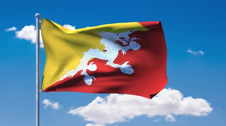 bhutan : Bhutanese flag waving over a blue cloudy sky