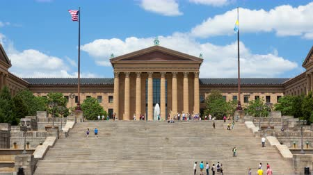 united states : Timelapse of people moving in front of the Philadelphia Art museum stairs steps - pennsylvania - USA Stock Footage