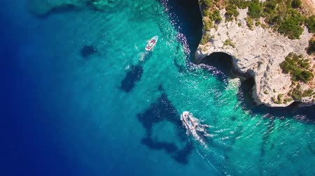 греческий : 4K (UHD) Aerial view of  Agios Nikolaos blue caves  in Zakynthos (Zante) island, in Greece Стоковые видеозаписи